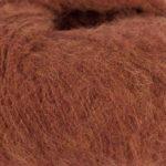 Bildet viser strikkegarnet Faeerytale fra Du store alpakka. Her i fargen 743 rustmelert.