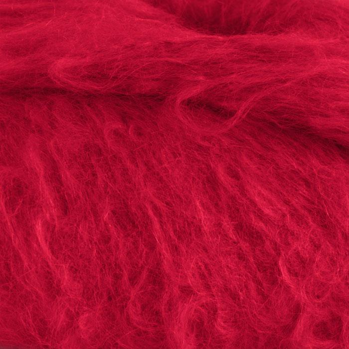 Bildet viser et utsnitt fra strikkegarnet Fnugg fra Camilla Pihl, her i fargen 907 rød.